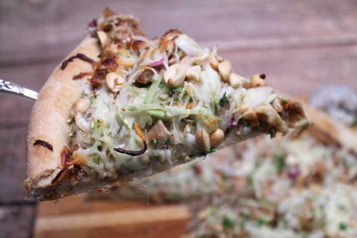 Thai Chicken Pizza closeup slice | 2 Cookin Mamas