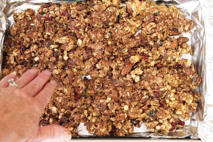 Trail Mix Granola Bars pat into pan | 2 Cookin Mamas