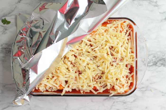 Cover casserole with foil and bake.
