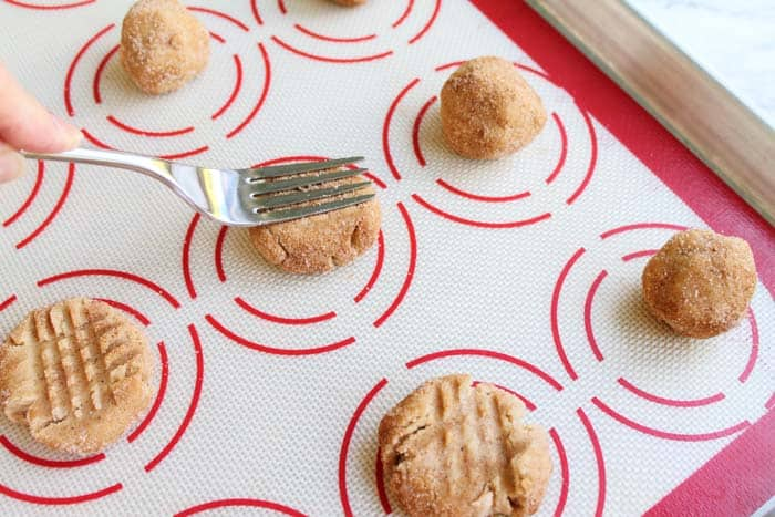 Peanut Butter Snickerdoodles press down with fork | 2 Cookin Mamas