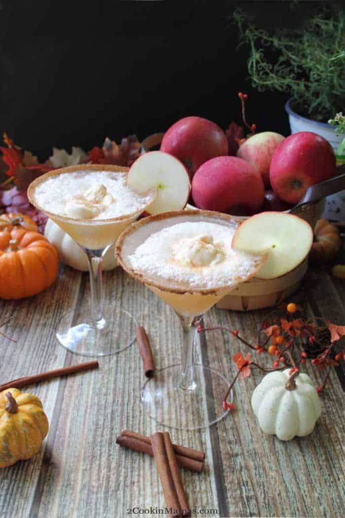 Apple Cider Float Cocktail tall | 2 Cookin Mamas Cheers to fall with our Apple Cider Float Cocktail! A delicious combination of apple cider, a dash of cinnamon, some chilled champagne and topped off with a scoop of vanilla ice cream. It's like a decadent for-adults-only ice cream float! #cocktail #fall #applecider #recipe #icecream #drink