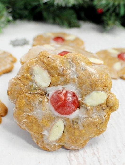 Closeup of german christmas cookie leaning against stack of cookies.