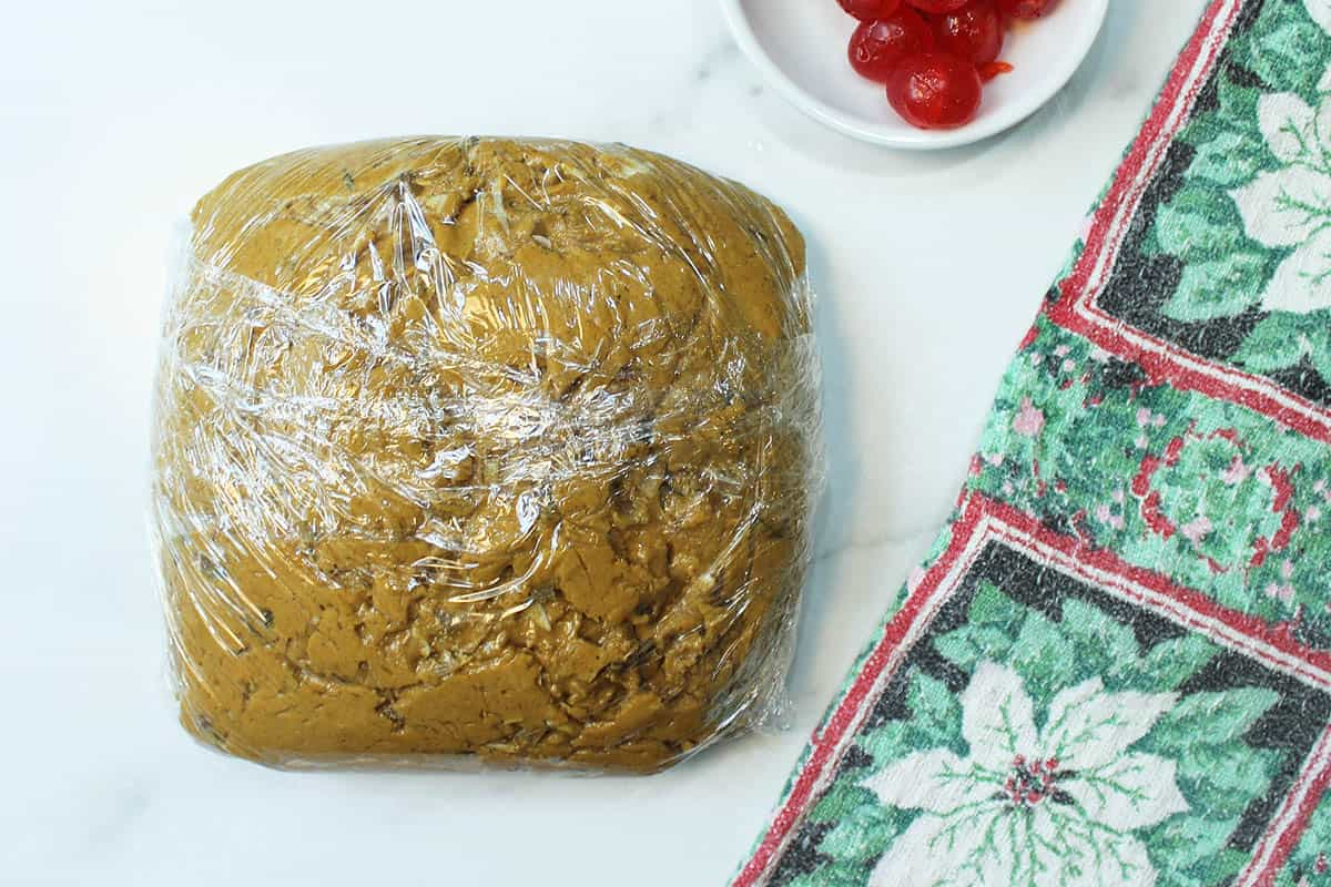 Dough wrapped in plastic wrap and ready to be refrigerated.