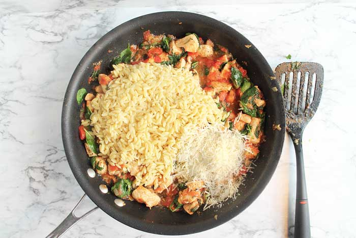 Garlic Chicken with Orzo adding orzo and cheese | 2 Cookin Mamas