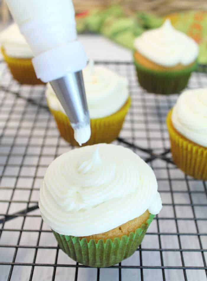 Easy Tequila Lime Cupcakes with Margarita Frosting piping frosting | 2 Cookin Mamas