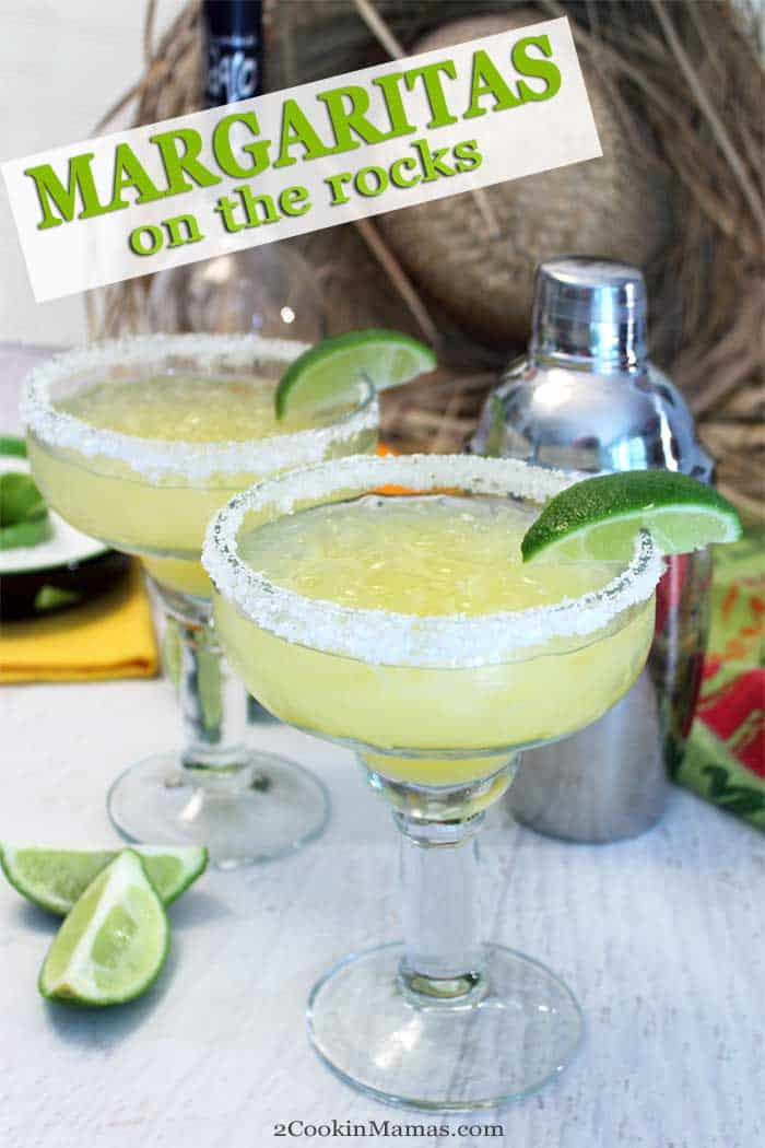 Margaritas on the rocks tall | 2 Cookin Mamas Salty, tart, crisp and delicious, these margaritas on the rocks, made with all fresh ingredients, will have you thinking Margaritaville. Perfect for upcoming Cinco de Mayo or as a cool refreshing cocktail when the summer heat hits. Serve over crushed ice or throw it in the blender for a cool frozen version. #margaritas #tequila #cocktail #recipe #CincodeMayo