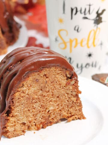 Slice of cake with I put a spell on you mug behind it.