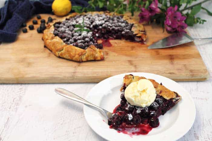 Easy Rustic Blueberry Galette slice   2 Cookin Mamas