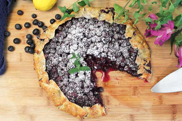 Easy Rustic Blueberry Galette baked piece cut out| 2 Cookin Mamas
