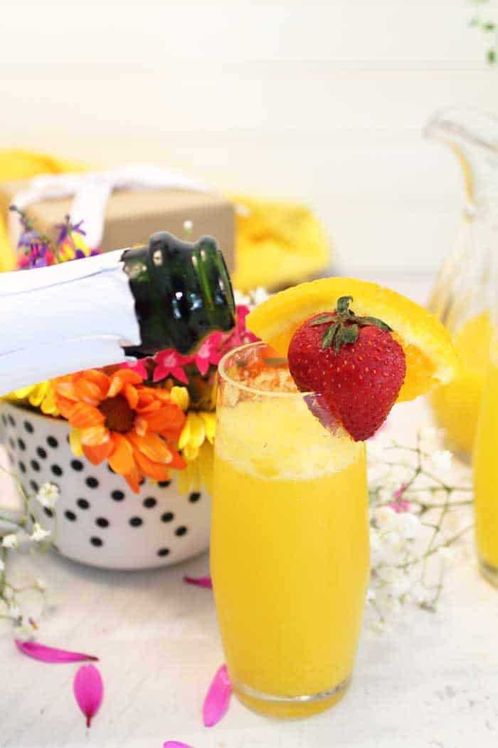 Sparkling Mimosas pouring champagne | 2 Cookin Mamas