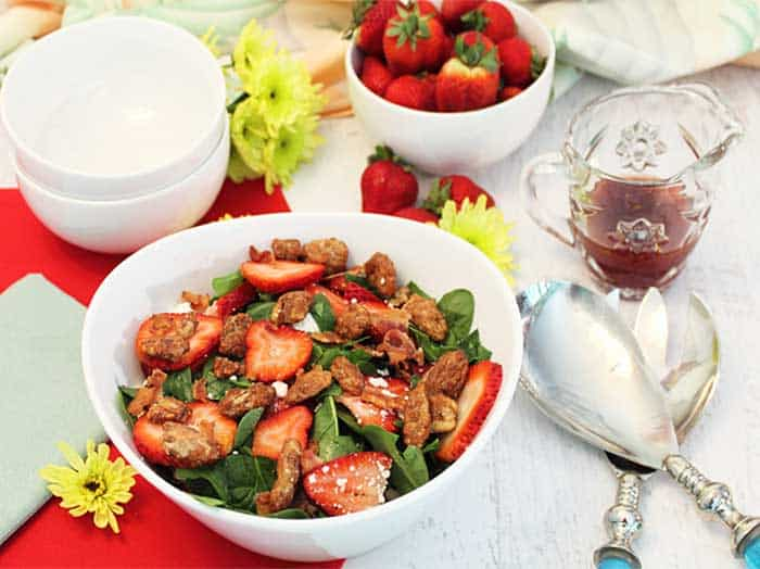 Spinach Strawberry Salad with Candied Pecans in white bowl