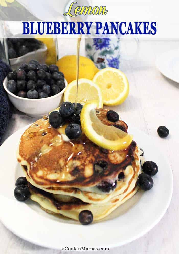 Lemon Blueberry Pancakes pin | 2 Cookin Mamas These light and fluffy Lemon Blueberry Pancakes bring the fresh flavors of summer to your table. Sweet blueberries are nestled into soft, flavorful lemon pancakes that will make breakfast the best meal of your day! #pancakes #blueberry #lemon #breakfast #recipe #fluffy #homemade
