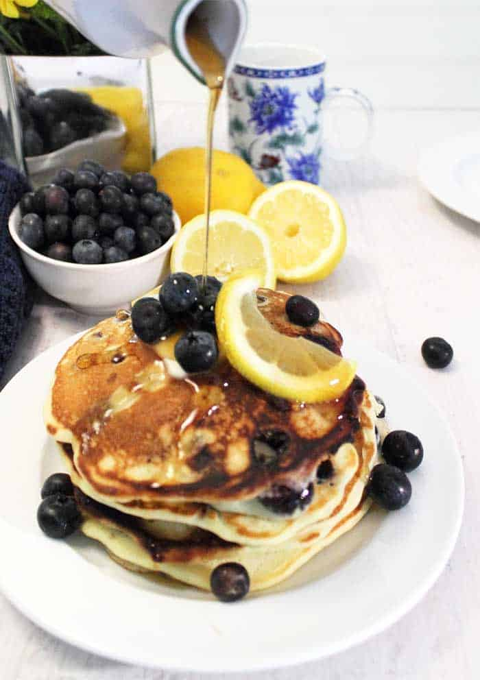 Lemon Blueberry Pancakes pouring syrup