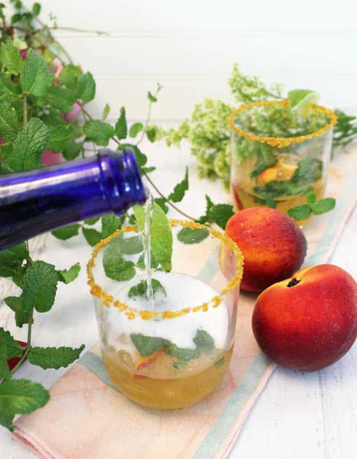 Sparkling Peach Mint Julep pouring prosecco   2 Cookin Mamas
