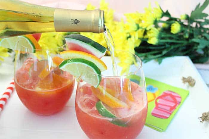 Watermelon Sangria pouring in wine
