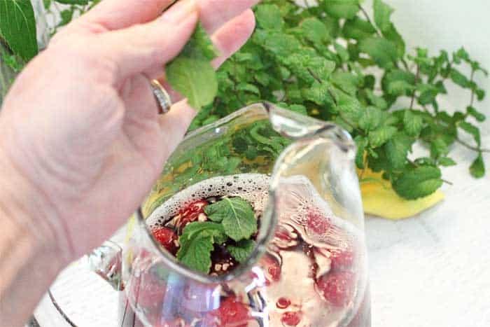 Raspberry Mint Iced Tea adding mint