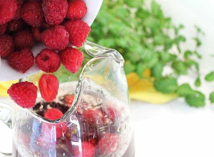Raspberry Mint Iced Tea adding raspberries