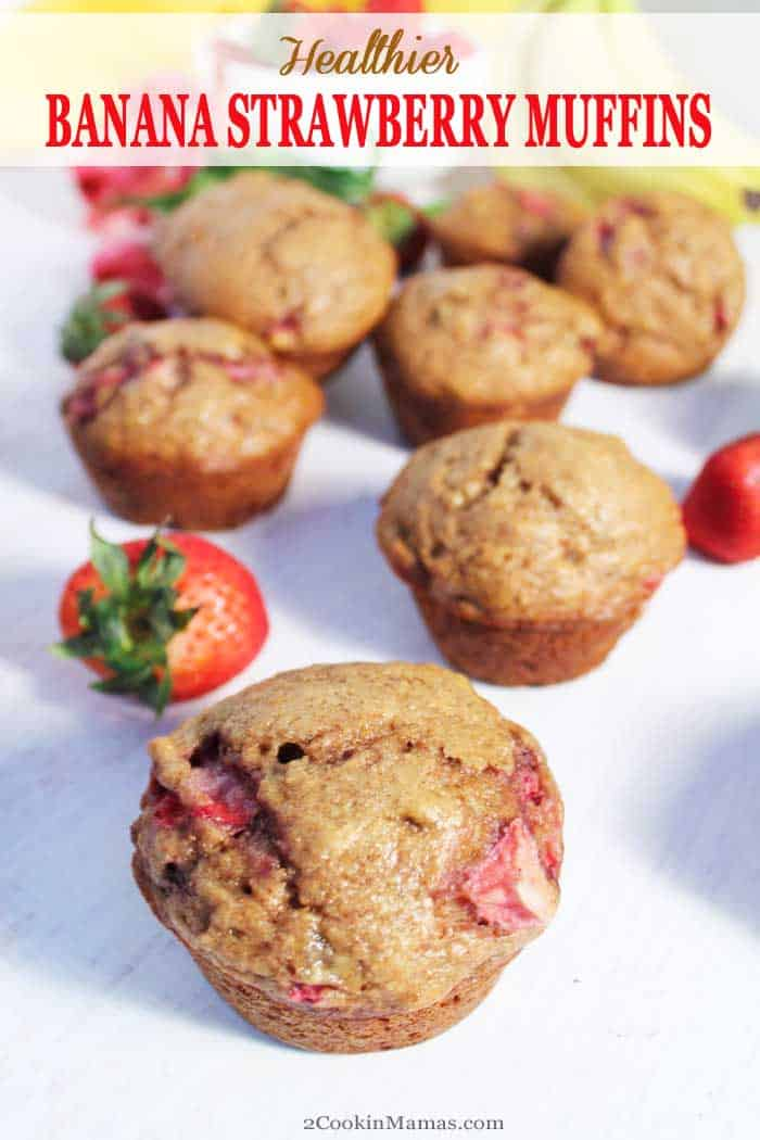Banana Strawberry Muffins pin | 2 Cookin Mamas Homemade Banana Strawberry Muffins are deliciously fruity, with juicy ripe strawberries and rich banana flavor that is reminiscent of banana bread. This recipe uses whole wheat flour, unsweetened applesauce and raw brown sugar to help make these muffins a healthier breakfast treat or after school snack. #muffins #bananamuffins #bananas #strawberries #recipe #breakfast #snack #healthy