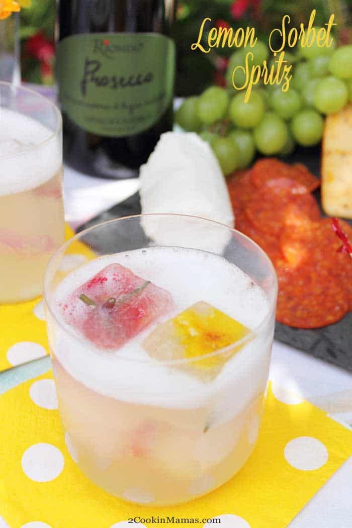 Lemon Sorbet Spritz main | 2 CookinMamas A light refreshing summer cocktail for everyday enjoyment. Prosecco & sparkling water give this cocktail with a vodka twist just the right amount of effervescence while the lemon sorbet ice cubes chill it to the perfect temperature. Great for backyard BBQs, picnics, happy hours and sipping oceanside. #ad #RiondoProsecco #nationalproseccoday #ItalianForsummer #riondococktail #cocktail #summer #recipe #prosecco #sorbet