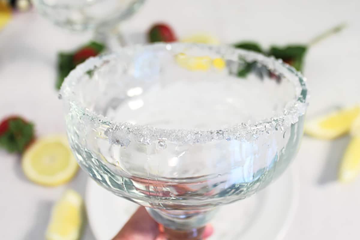 Closeup of sparkling sugar rim on margarita glass.