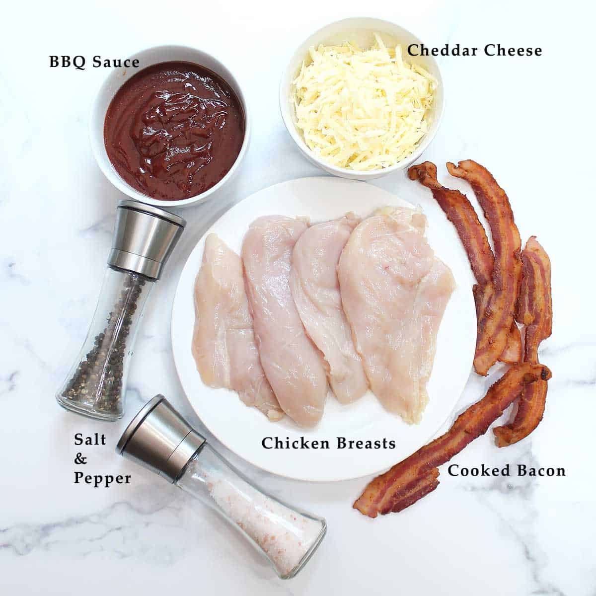 BBQ Baked Chicken Breast ingredients on white table.