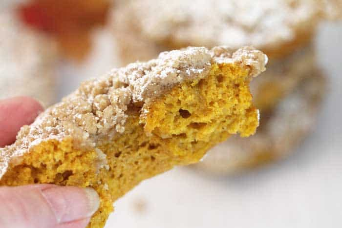Baked Pumpkin Doughnuts with Crumb Topping bite closeup