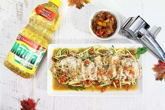 Bruschetta Chicken Skillet with zoodles overhead plated with Mazola