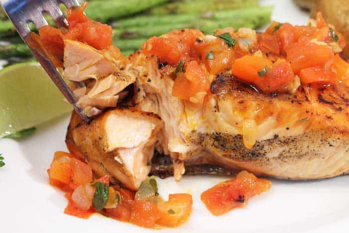 Grilled Salmon with Red Pepper Sauce bite closeup