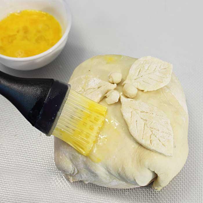Chocolate Honey Walnut Baked Brie brushing with egg wash