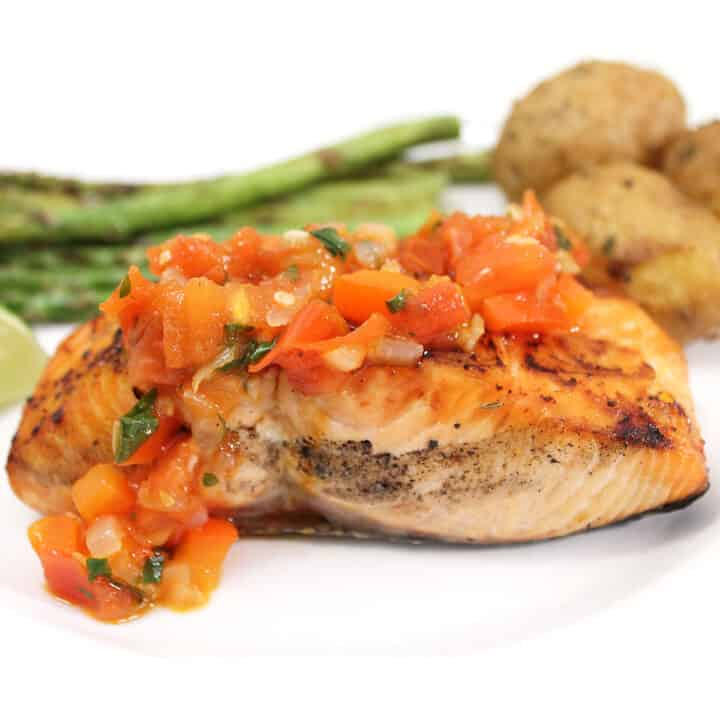Grilled Salmon with Red Pepper Sauce plated closeup.