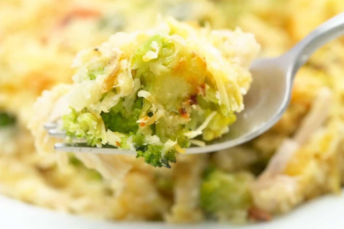 Bite of chicken broccoli casserole on fork.