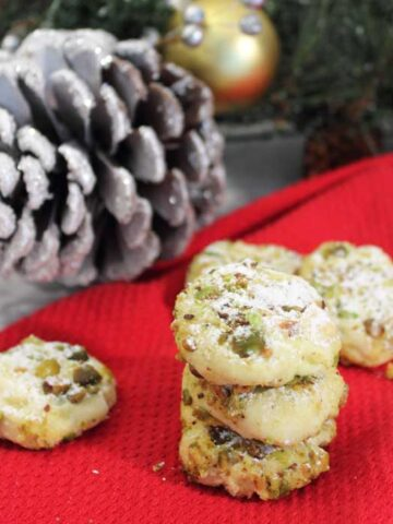 Pistachio Whipped Shortbread Cookies square with pinecone