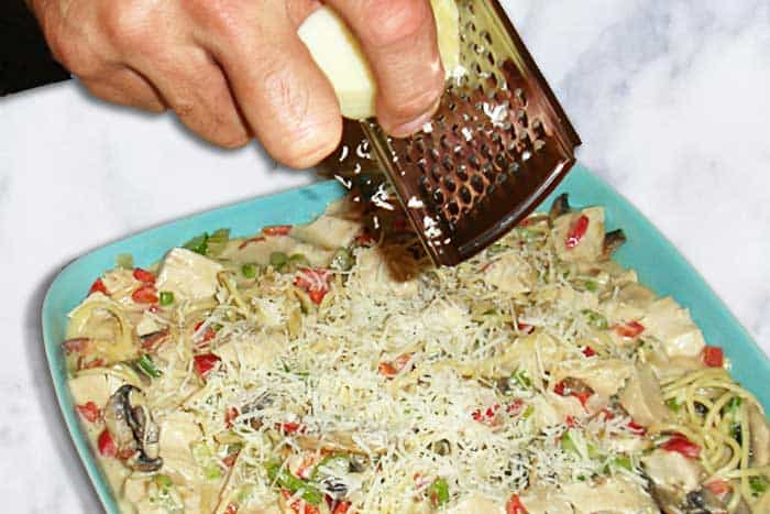 Turkey Tetrazzini sprinkle with grated cheese