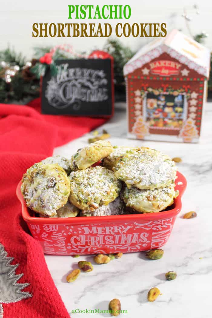 Melt in your mouth Pistachio Whipped Shortbread Cookiesare crumbly, soft, buttery and slightly sweet. There's a hint of flavor from the liqueur, an added richness from the white chocolate chips and a nice crunch from the pistachios. Easy to make and a great addition to your Christmas cookie tins. #shortbread #cookies #christmas #christmascookies #recipe #pistachios #whitechocolate #whipped