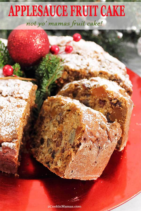 This Applesauce Spice Fruit Cake is not your mama\'s fruit cake! A moist, dense, spicy cake, moistened with applesauce and filled with chopped nuts, coconut, raisins, dates and orange candy slices. It\'s a holiday tradition that just got tastier. Perfect sprinkled with powdered sugar or drizzled with a little caramel sauce. #cake #fruitcake #spicecake #dessert #Christmas #applesaucespicecake #recipe #baking