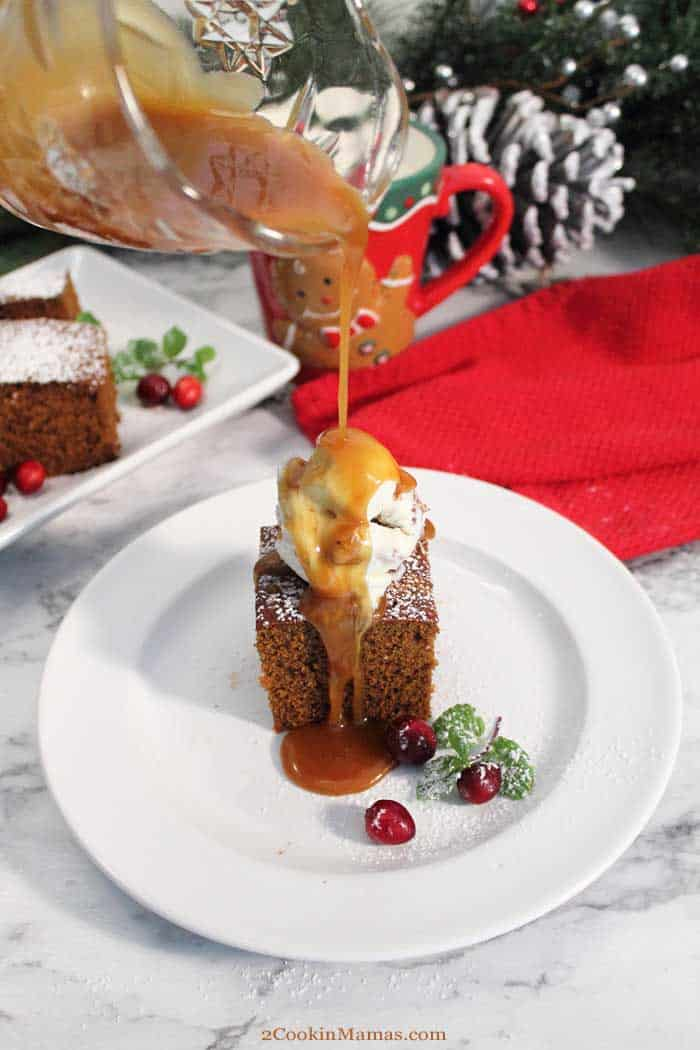 Homemade Spicy Gingerbread pouring caramel tall | 2 Cookin Mamas Our Gingerbread quick bread is full of rich molasses flavor & spiced up with plenty of ginger & cinnamon. Sure to be a favorite for breakfast or dessert! #gingerbread #breakfastbread #quickbread #dessert