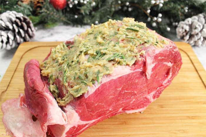 How to Cook the Perfect Standing Rib Roast cut fat back and apply garlic herb paste