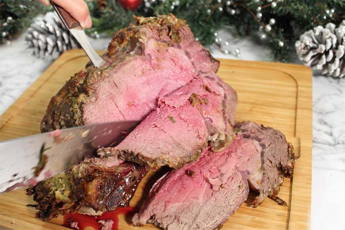How to Cook the Perfect Standing Rib Roast slicing meat