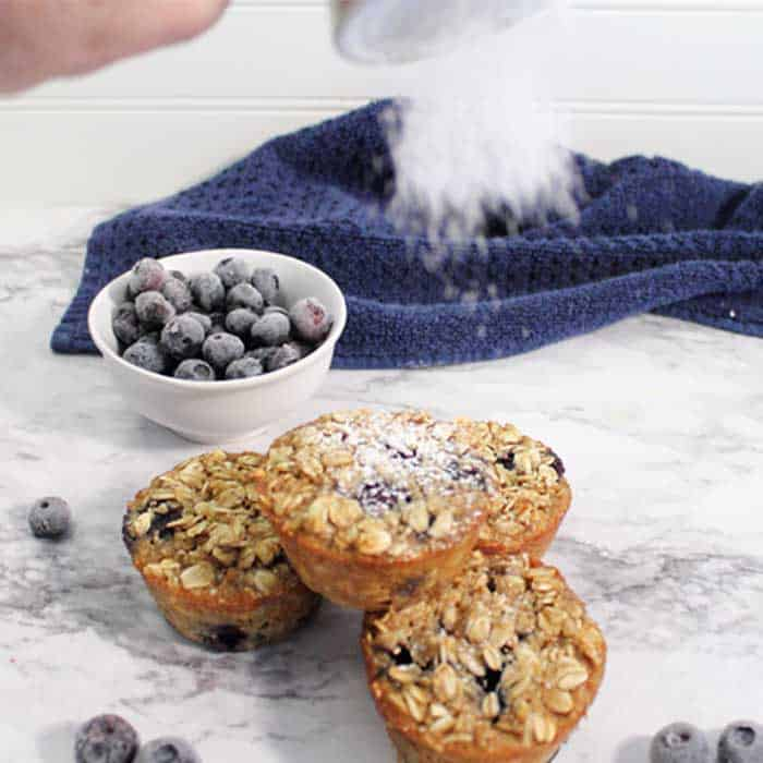 Blueberry Yogurt Oatmeal Muffins sprinkle with powdered sugar