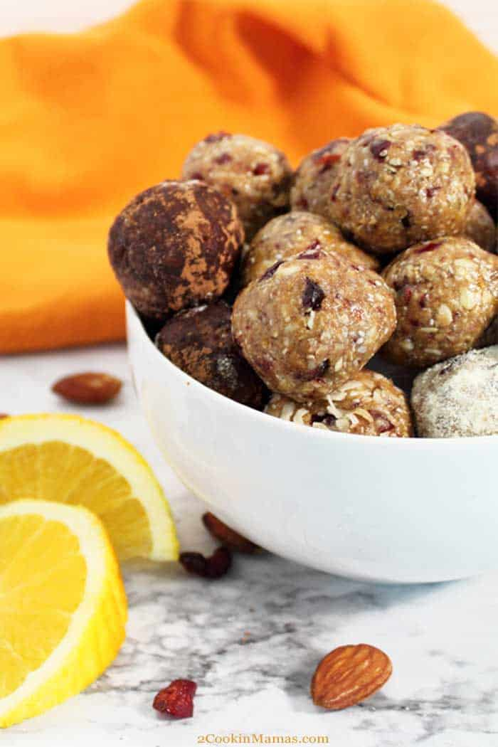 Cranberry Orange Energy Balls tall | 2 Cookin Mamas Cranberry Orange Energy Balls are filled with protein, fiber and antioxidants to refuel you after your workout or give you a quick on-the-go breakfast for rushed mornings. Packed with oats, almonds, cranberries, chia seeds, orange juice and almond butter, they're a tasty bite that's actually healthy. #snack #energyballs #healthy #nobake #protein #oats #lowcarb #almondbutter #recipe #cranberries #chiaseeds #almonds #glutenfree
