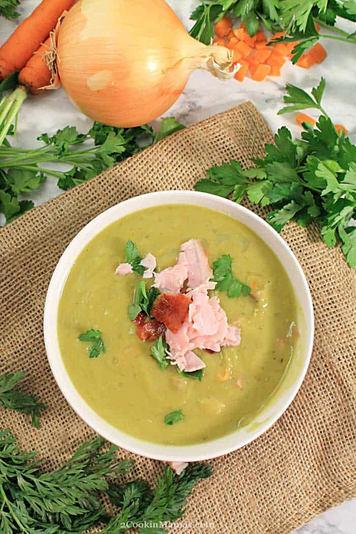 Instant Pot Split Pea Soup tall | 2 Cookin Mamas This Instant Pot Split Pea Soup is a rich, warming soup that can be on the dinner table in 30 minutes! It has a rich split pea base with a wonderful smoked ham flavor running through it. The additional ham, carrots and celery bring a bit more vitamins and minerals to the mix for a healthy, hearty, meal in a bowl. The perfect comfort food for keeping warm this winter. #peasoup #instantpot #soup #winter #30minutemeal #recipe #splitpeas #dinner #comfortfood