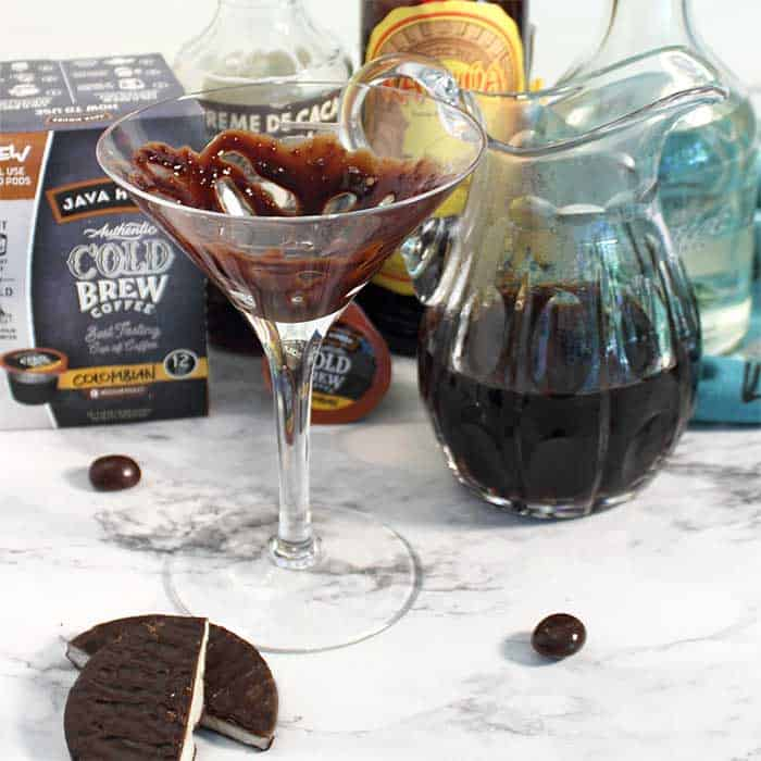 Coat the cocktail glass with chocolate syrup