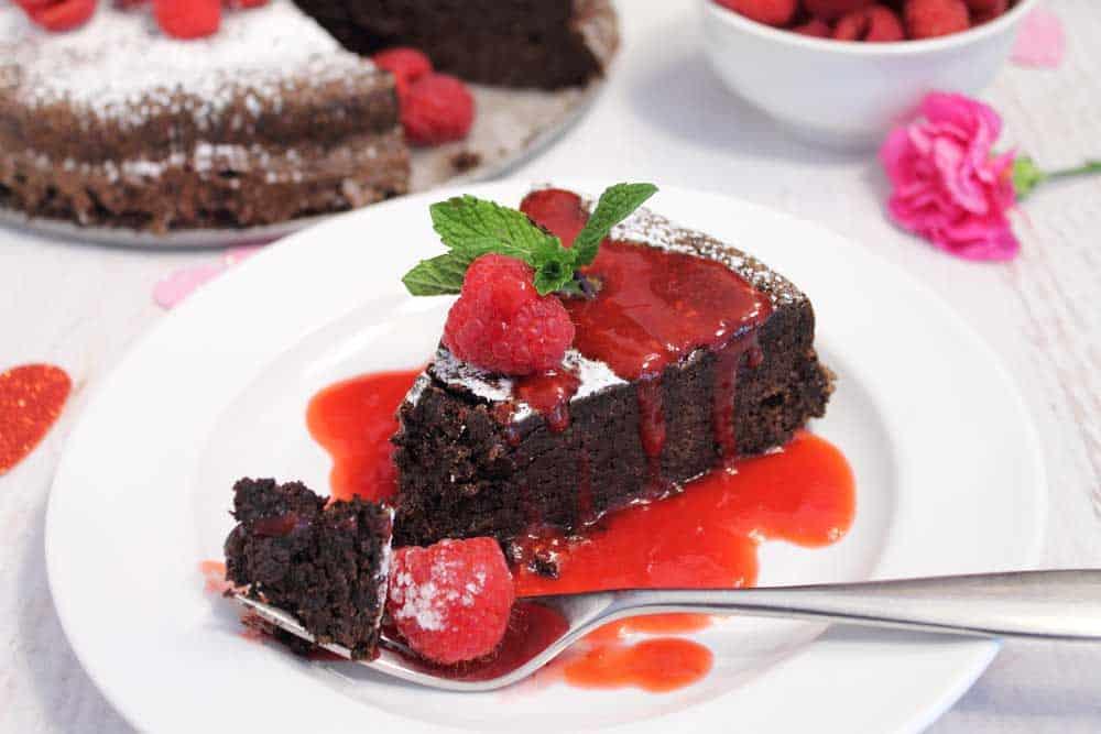Flourless Chocolate Torte with raspberry sauce and bite