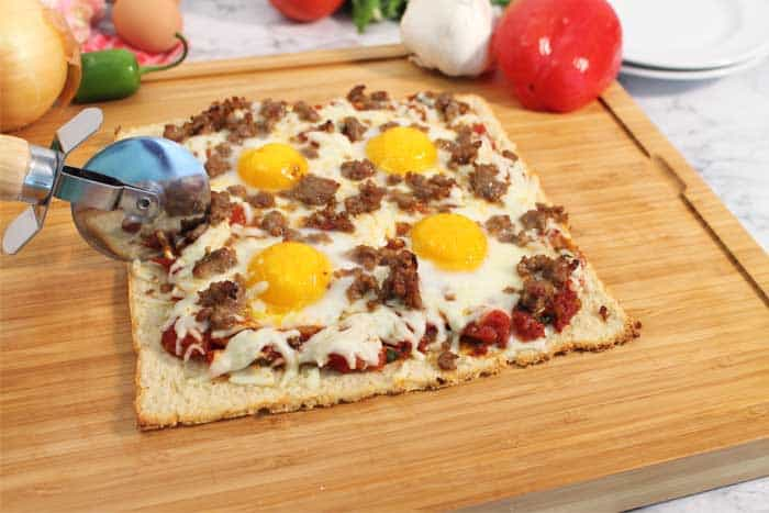 Shakshuka Breakfast Pizza slicing