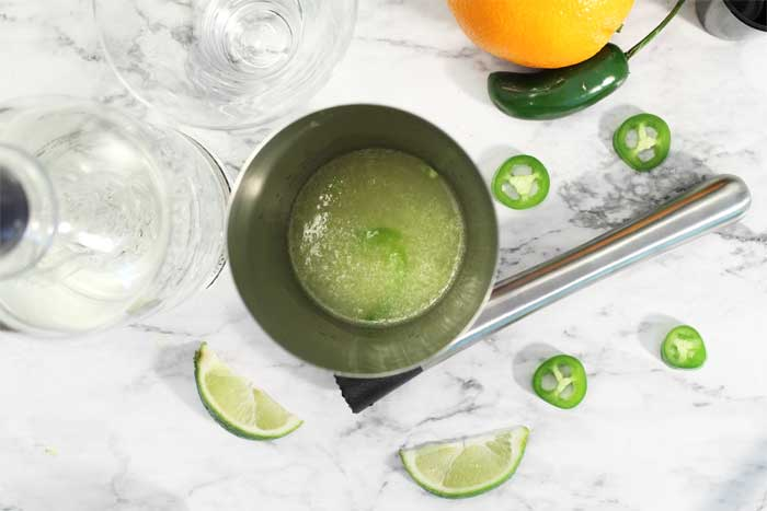 Spicy Sparkling Citrus Margarita muddling