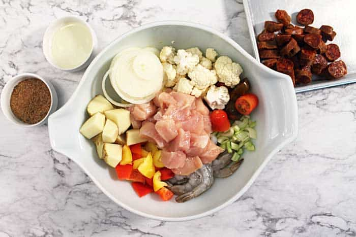 Cut up meat and vegetables in bowl