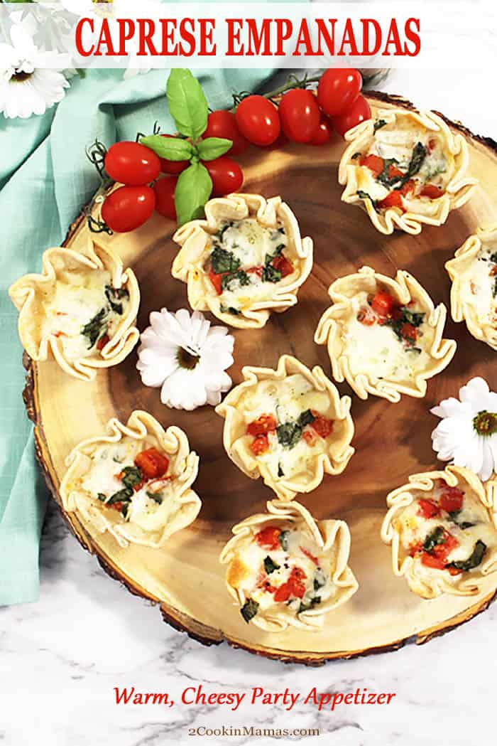 Caprese Empanadas are delicious, easy to make appetizers made with all your favorite caprese salad ingredients. Tomatoes, fresh basil and mozzarella cheese fill a premade empanada shell and simply baked in a muffin pan. Warm and tasty handheld open-faced empanandas great for game time, summer parties and barbecues.  #appetizer #easy #empanada #gameday #party #easy #recipe #summer #caprese #newyearseve