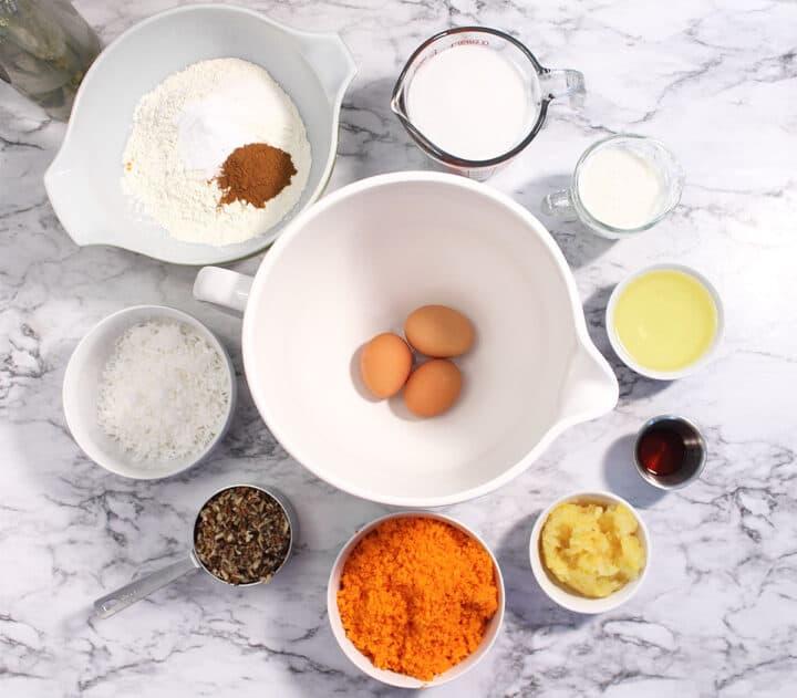 Carrot Sheet Cake ingredients on marble surface.