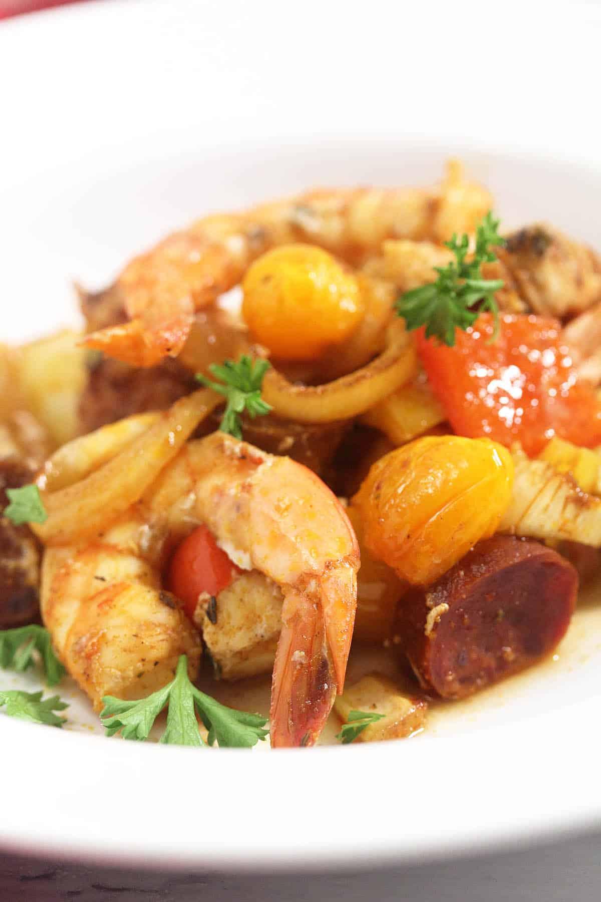 Closeup of plated creole sheet pan dinner.