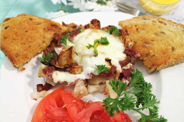 Corned Beef Hash breakfast on white plate closeup
